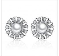Glamurozni uhani iz srebra s čarobnim kristalom