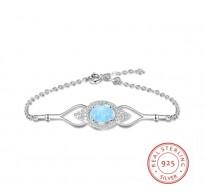 Srebrna zapestnica s kristali in opalom v obliki očesa