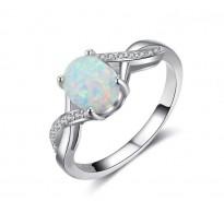 Čaroben srebrn prstan z modrim opalom in kristali