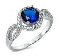 Graciozen srebrn prstan s kristalom barve modrega safirja