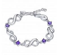 Zapestnica srebrna, vijolični kristali kubični cirkonij